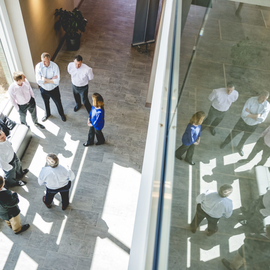 photo looking down onto a group of people in modern building
