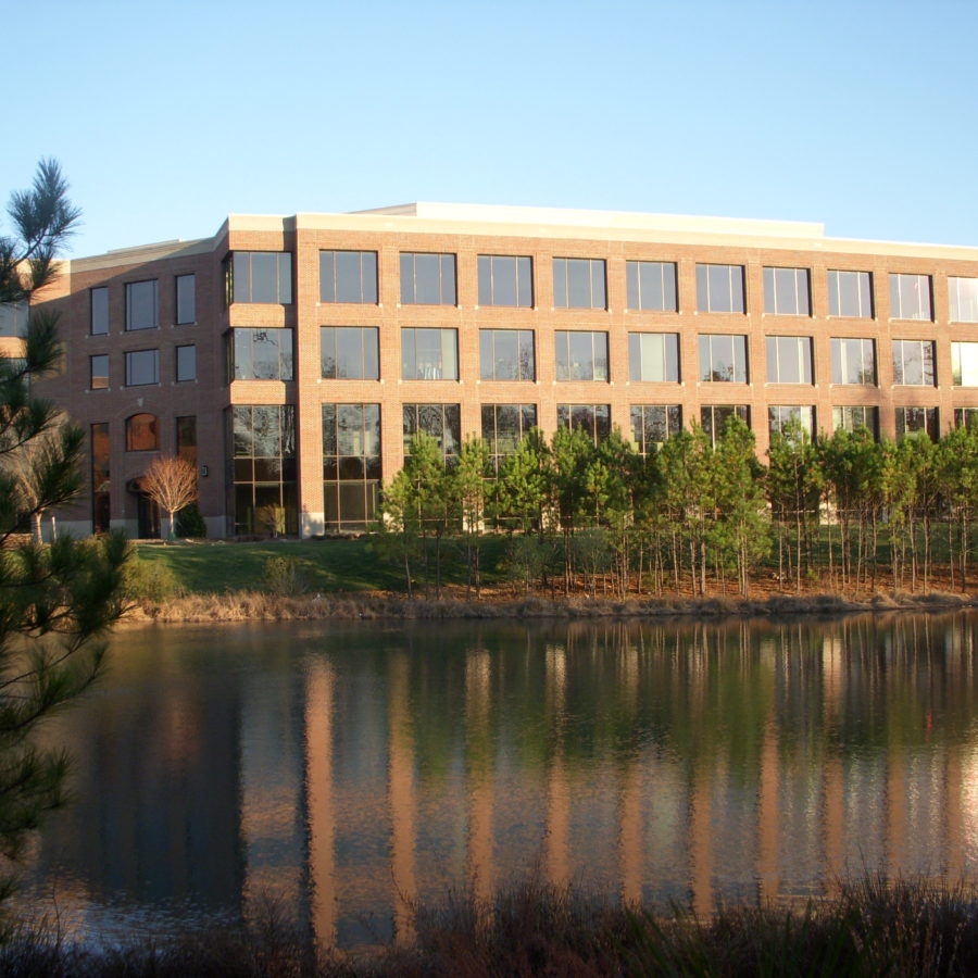 office building overlooking lake