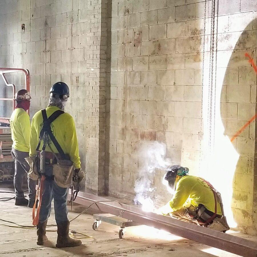 Constructin workers working on steel beam